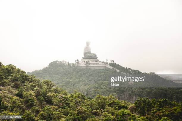the tian tan buddha from a distance - third place stock pictures, royalty-free photos & images