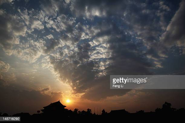 The Tiananmen Gate is seen under the sunset on June 4 2012 in Beijing China