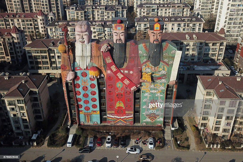 The Tianzi Hotel with the shape of Chinese deities Fu, Lu and Shou is pictured on November 20, 2017 in Langfang, Hebei Province of China. The 41.6-meter-tall Tianzi Hotel has an exterior of Chinese Sanxing, whose names are Fu, Lu and Shou with the qualities of prosperity, status and longevity in traditional Chinese culture, in Langfang city.