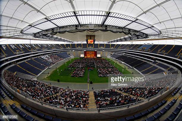 The Tibetan spiritual leader Dalai Lama addresses the faithful during his visit in the Commerzbank Arena on July 30 2009 in Frankfurt am Main Germany...