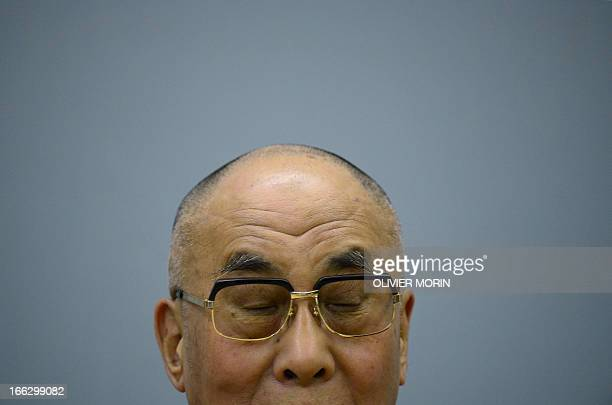 The Tibetan spiritual leader Dalai Lama reacts during a press conference on April 11 2013 in Trento after receiving the award of Minorities by the...