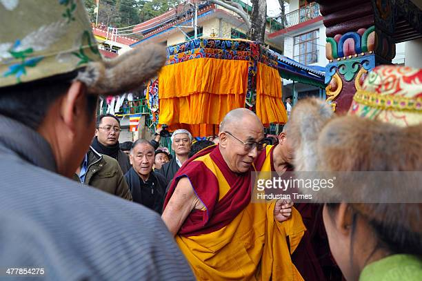 The Tibetan spiritual leader The Dalai Lama arrives to inaugurate a new building for Tibetan ParliamentinExile on March 11 2014 in McLeodganj near...