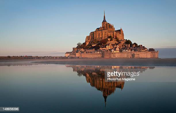 The tidal island of Mont SaintMichel on the Normandy coast at sunrise taken on October 15 2011