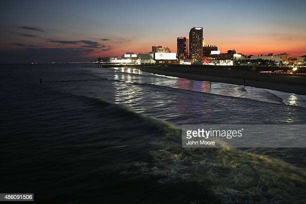 The tide rolls in towards Atlantic City's boardwalk and casino hotels on August 26 2015 in Atlantic City New Jersey New casinos in neighboring states...