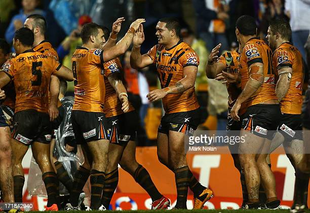 The Tigers celebrate a try by Benji Marshall on full time during the round 16 NRL match between the Wests Tigers and the Melbourne Storm at...