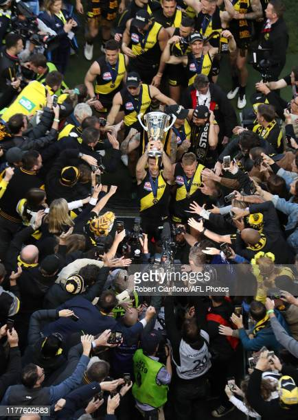 The Tigers celebrate after defeating the Giants during the 2019 AFL Grand Final match between the Richmond Tigers and the Greater Western Sydney...