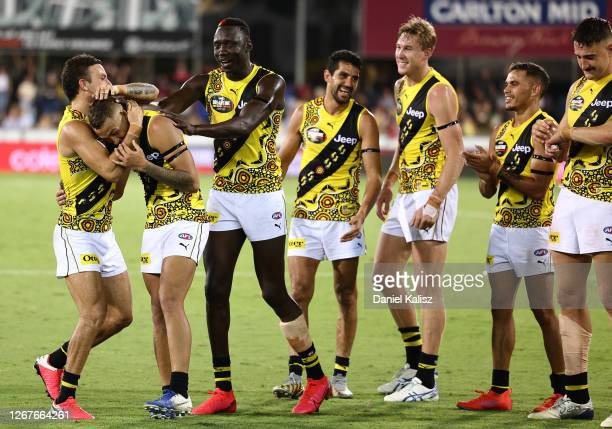 The Tigers celebrate after they defeated the Bombers during the round 13 AFL match between the Essendon Bombers and the Richmond Tigers at TIO...