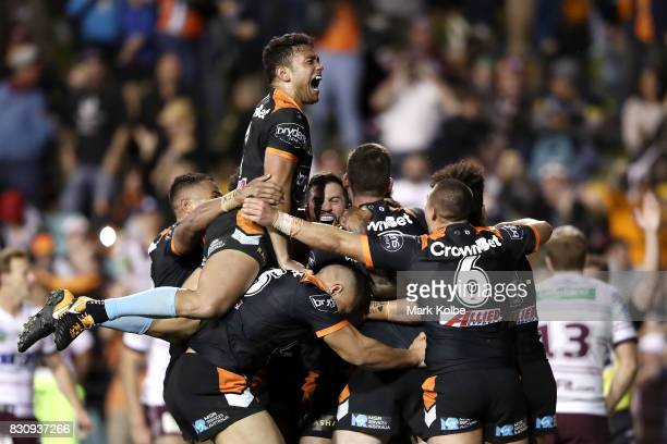 The Tigers celebrate the winning try scored by Malakai WateneZelezniak of the Tigers during the round 23 NRL match between the Wests Tigers and the...