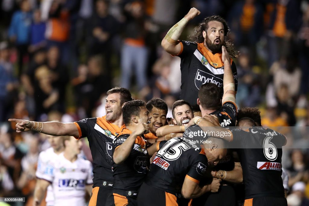 The Tigers celebrate the winning try scored by Malakai Watene-Zelezniak of the Tigers during the round 23 NRL match between the Wests Tigers and the Manly Sea Eagles at Leichhardt Oval on August 13, 2017 in Sydney, Australia.