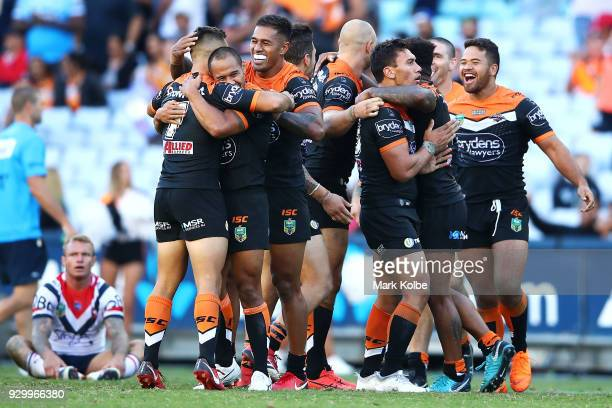 The Tigers celebrate victory during the round one NRL match between the Wests Tigers and the Sydney Roosters at ANZ Stadium on March 10 2018 in...