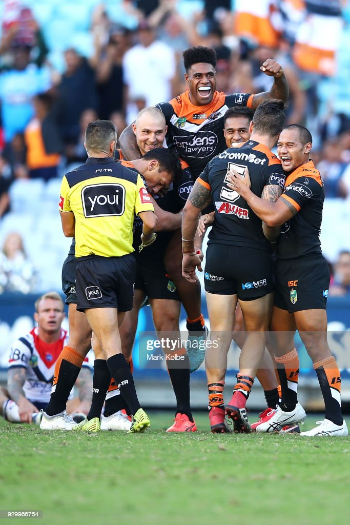 The Tigers celebrate victory during the round one NRL match between the Wests Tigers and the Sydney Roosters at ANZ Stadium on March 10, 2018 in Sydney, Australia.
