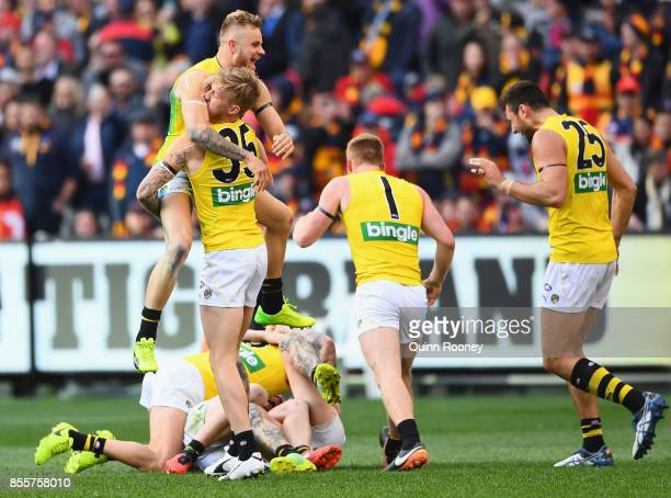 The Tigers celebrate winning the 2017 AFL Grand Final match between the Adelaide Crows and the Richmond Tigers at Melbourne Cricket Ground on...