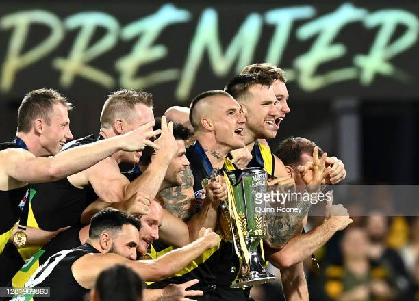 The Tigers celebrate with the Premiership Cup after winning the 2020 AFL Grand Final match between the Richmond Tigers and the Geelong Cats at The...