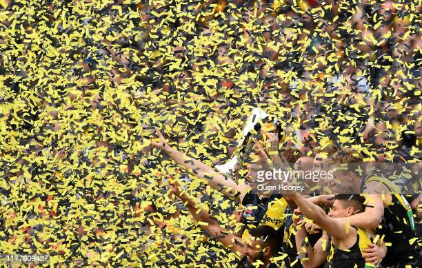 The Tigers celebrate with the Premiership Trophy during the 2019 AFL Grand Final match between the Richmond Tigers and the Greater Western Sydney...