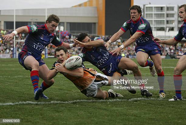 The Tigers' Dean Collis loses the ball in a tackle over the line in the final few minutes of the Round 10 NRL rugby league match between the...