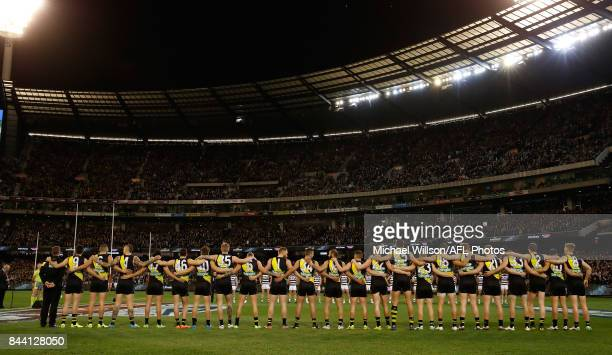 The Tigers line up for the national anthem during the AFL Second Qualifying Final Match between the Geelong Cats and the Richmond Tigers at Melbourne...