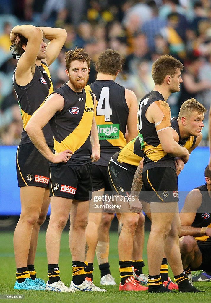The Tigers look dejected after losing the First AFL Elimination Final match between the Richmond Tigers and the North Melbourne Kangaroos at Melbourne Cricket Ground on September 13, 2015 in Melbourne, Australia.