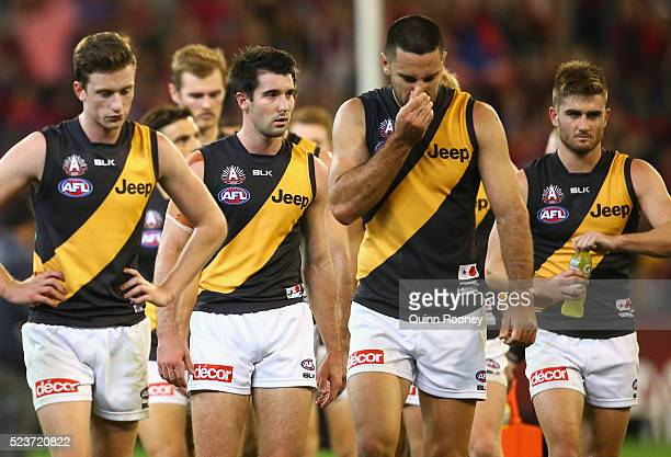 The Tigers look dejected after losing the round five AFL match between the Melbourne Demons and the Richmond Tigers at Melbourne Cricket Ground on...
