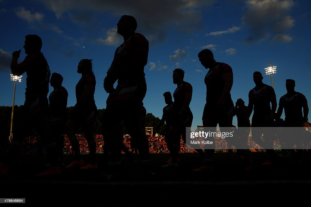 The Tigers return to the dressing rooms after their warm-up before the round 16 NRL match between the Wests Tigers and the Penrith Panthers at Leichhardt Oval on June 28, 2015 in Sydney, Australia.