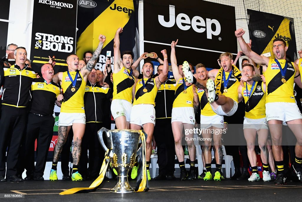 The Tigers sing the song in the rooms after winning the 2017 AFL Grand Final match between the Adelaide Crows and the Richmond Tigers at Melbourne Cricket Ground on September 30, 2017 in Melbourne, Australia.