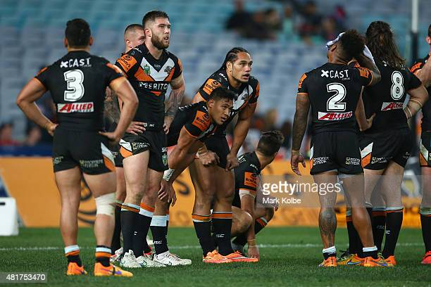 The Tigers team look dejected after a Roosters try during the round 20 NRL match between the Wests Tigers and the Sydney Roosters at ANZ Stadium on...