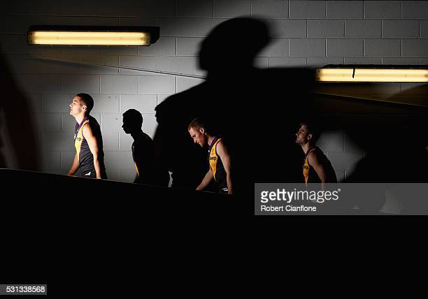 The Tigers walk out for the round eight AFL match between the Richmond Tigers and the Sydney Swans at Melbourne Cricket Ground on May 14 2016 in...