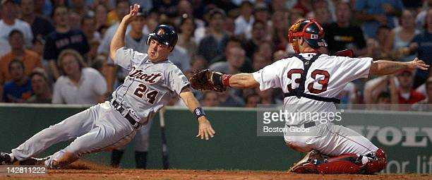 The Tigers Warren Morris is out at the plate tagged by Red Sox catcher Jason Varitek as he tried to score on Dmitri Young's sixth inning double...