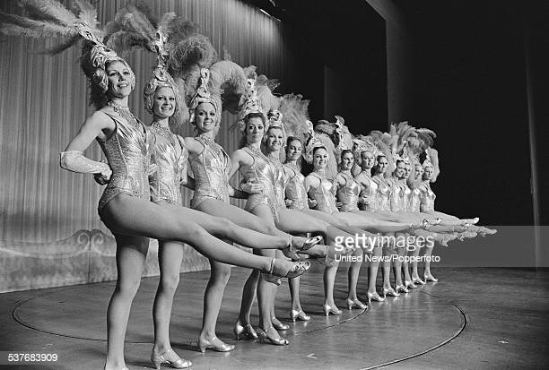 The Tiller Girls dance troupe perform a synchronised kick routine on stage at the Palladium theatre in London on 25th October 1973