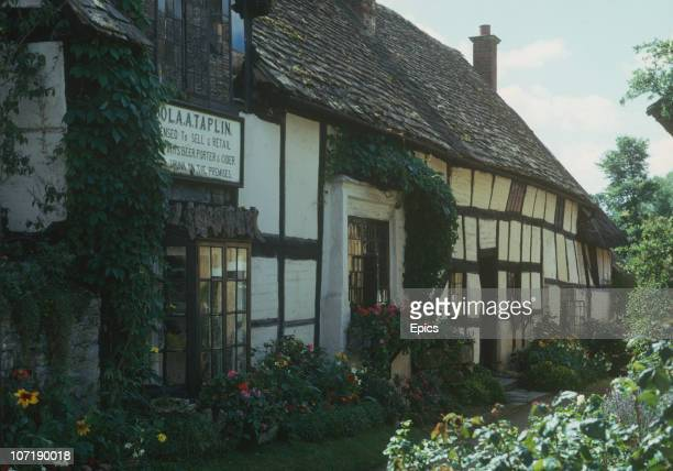 The timbered exterior of the Fleece Inn public house in the rural village of Bretforton Evesham Worcestershire August 1974 It was originally built as...