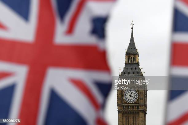 The time 12:20pm shows on Big Ben on March 29, 2017 in London, England. The British Prime Minister Theresa May addresses the Houses of Parliament as...