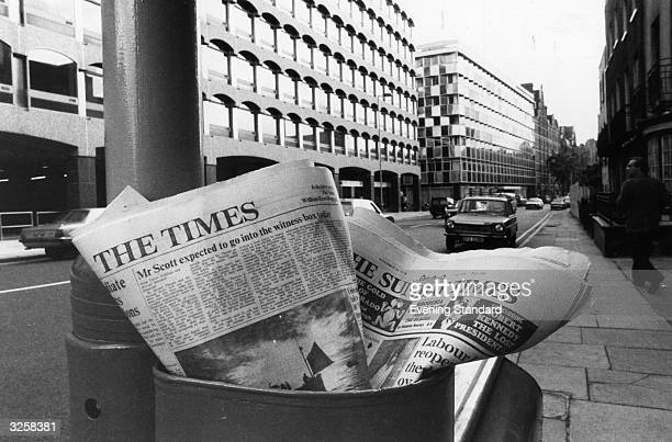 The Times and The Sunday Times, two quality broadsheets, left in a litter bin, just down the road from The Times offices in Gray's Inn Road, London.