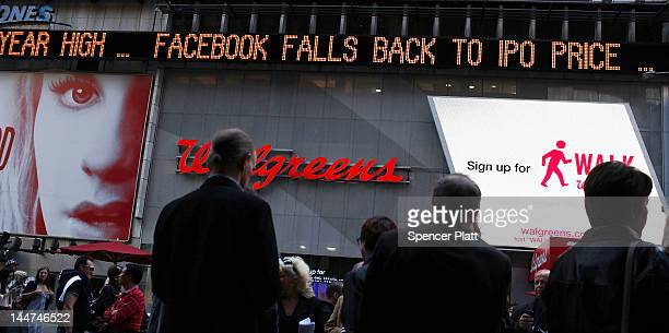 The Times Square news ticker displays a headline about the newly debuted Facebook stock price at the end of the trading day on May 18 2012 in New...
