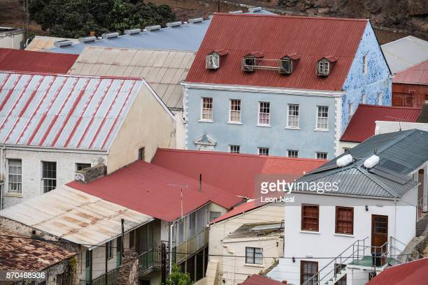 The tinroofed homes and businesses of Jamestown are seen from above on October 26 2017 in Jamestown Saint Helena Following the introduction of weekly...