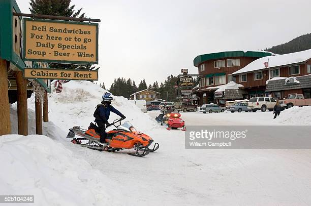 The tiny town in the AbsorkaBeartooth Mountains of Montana is a destination for snowmobiling Large snowfalls attract extreme snowmobilers Two...