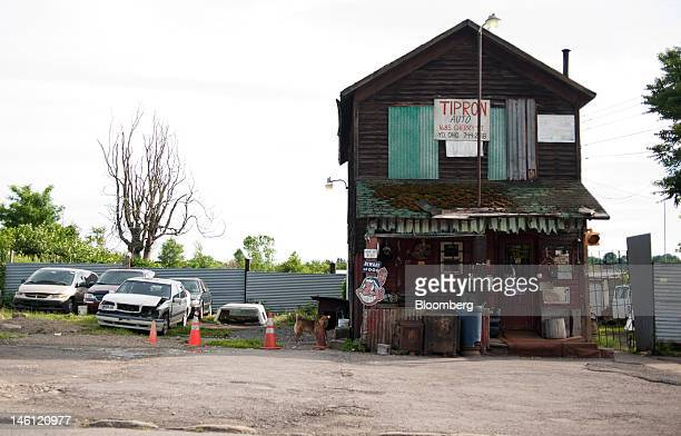 The Tipron Auto service building stands outside downtown Youngstown Ohio US on Friday June 8 2012 Hydraulic fracturing or fracking is bringing new...