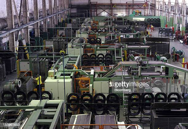 The tire assembly line is seen at the ZAO Sibur Holding tire manufacturing plant in Voronezh, Russia, on Friday, Nov. 18, 2011. Pirelli is buying two...