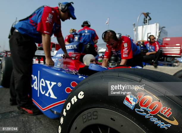 The tire of Dario Franchitti's Andretti Green Racing ArcaEx Honda Dallara is marked to commemorate the 100th IRL race during practice for the Indy...