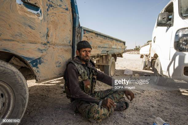 The tired worrior An SDF fighter is taking a rest before a new attack at the evening The Syrian civil war has been carried on for more than 6 years...