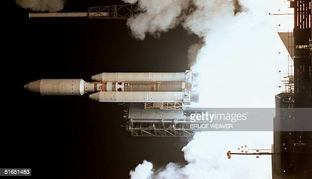 The Titan 4B launch vehicle blasts off launch pad 40 at Cape Canaveral Air Force Station in Florida 15 October carrying the Cassini space probe into...