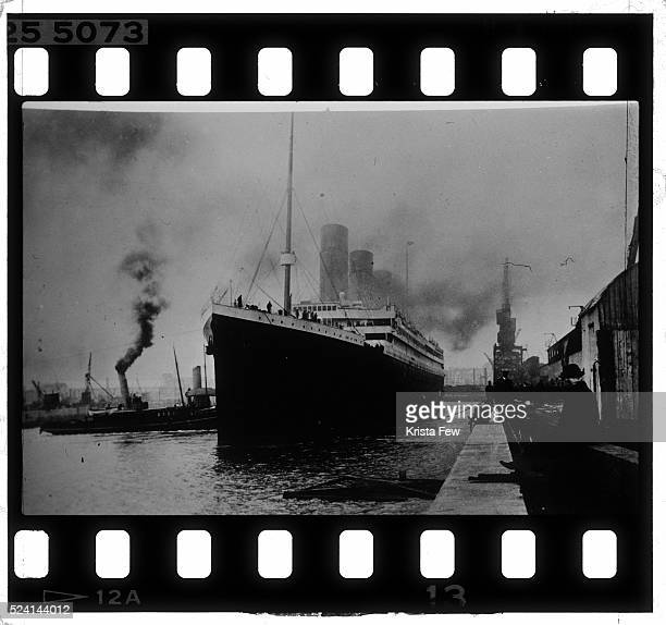 The Titanic sails away from the dock at either Southampton England or Belfast Ireland The Titanic hit an iceberg and sank on her maiden voyage on...