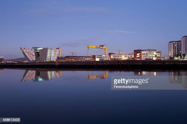 the titanic visitor centre building at dusk belfast northern ireland - belfast stock pictures, royalty-free photos & images