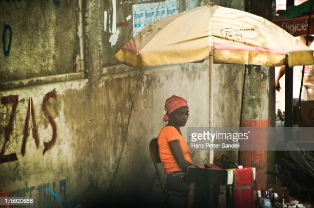 The title? Stolen from the umbrella.... The unemployment rate in Haiti is somewhere close to 80%. Most street merchants are among those 80% but also...