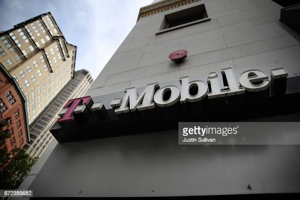 The T-Mobile logo is displayed outside of a T-Mobile store on April 24, 2017 in San Francisco, California. T-Mobile will report first quarter...