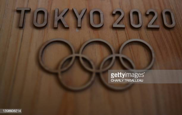The Tokyo 2020 logo is pictured in Sagamihara on March 30 2020 Postponed Tokyo Olympics to open July 23 organisers said on March 30 announcing the...