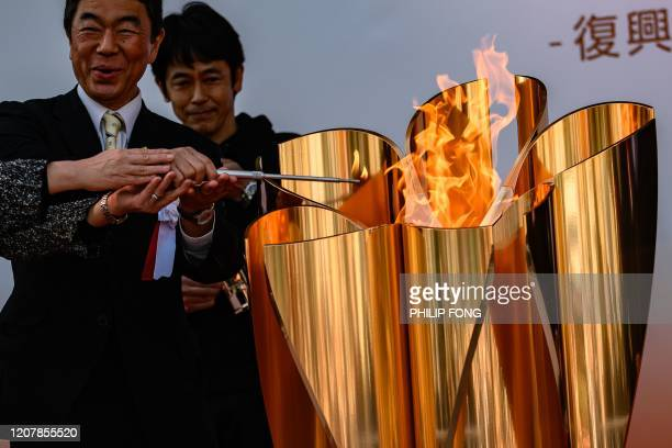 The Tokyo 2020 Olympic flame is lit outside Sendai railway station Miyagi prefecture on March 21 after arriving from Greece