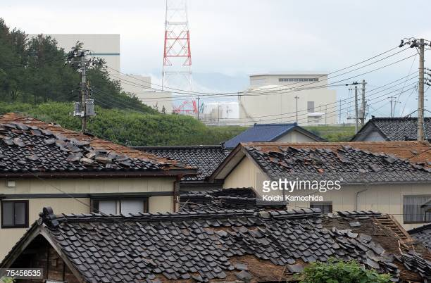The Tokyo Electric Power Co KashiwazakiKariwa Nuclear Power Plant is seen in the distance following Monday's magnitude 68 earthquake on July 18 2007...