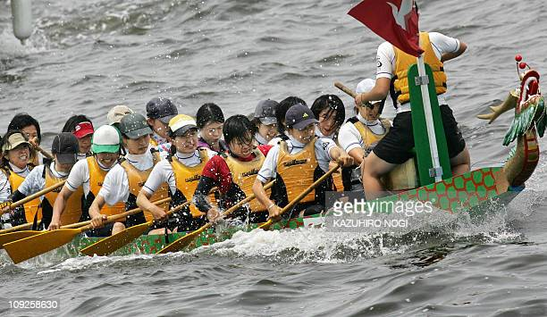 The Tokyo Madona women's team row in the final of the Sunday Challenge Cup at the Yokohama Dragon Boat Race in Yokohama 04 June 2006 Thirtytwo teams...
