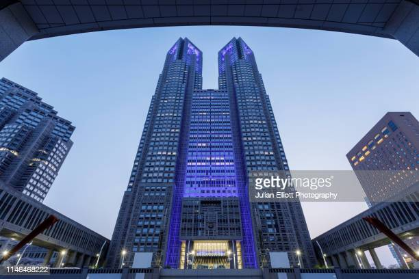the tokyo metropolitan government building in tokyo, japan. - headquarters stock pictures, royalty-free photos & images