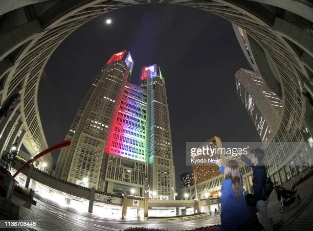 The Tokyo metropolitan government building is lit up in Paralympic symbol colors on April 13 as the day marked the start of a 500day countdown to the...