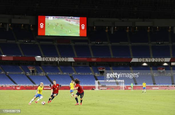 The Tokyo Olympic men's football gold medal match between Brazil and Spain is played behind closed doors amid the coronavirus pandemic on Aug. 7 at...